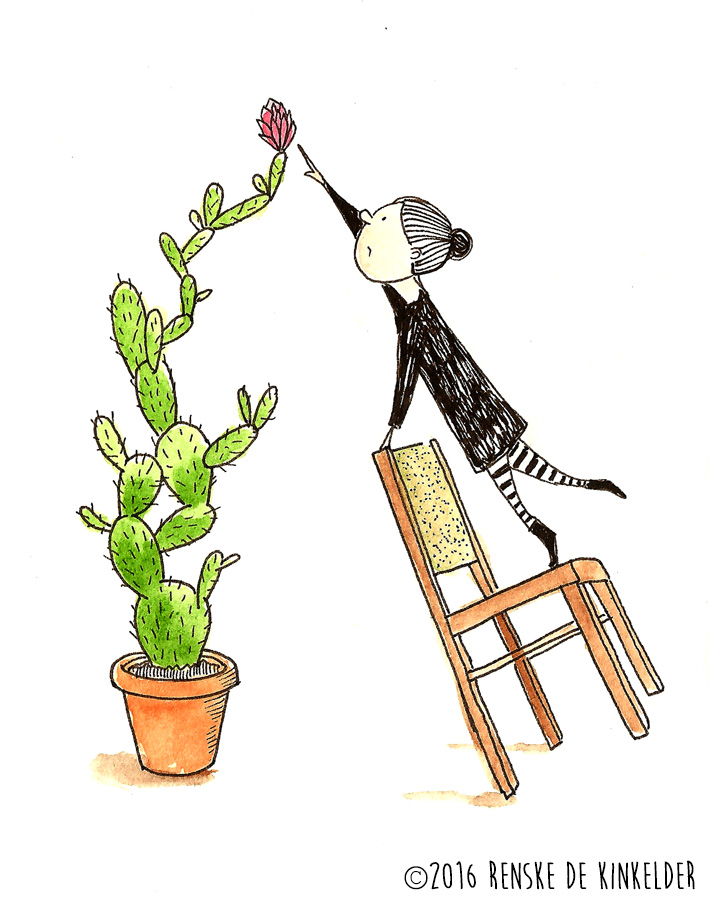 Girl standing on chair, reaching for a high flower in a big cactus