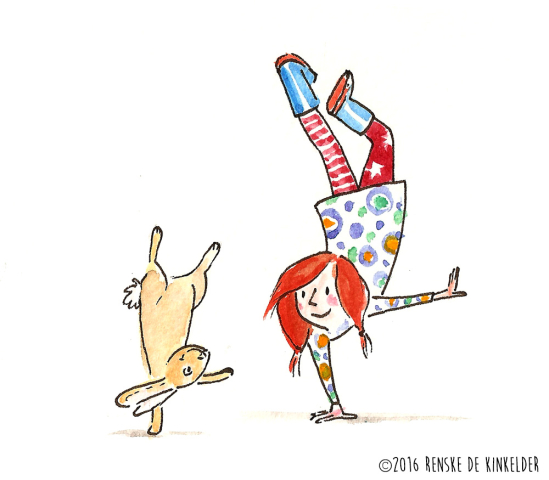 redheaded girl doing a handstand with a rabbit